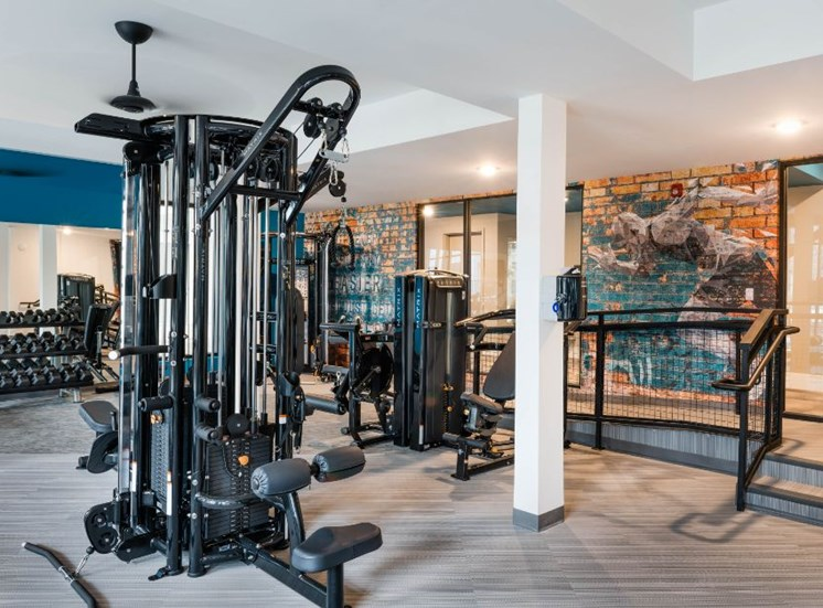 Fitness Center with Exercise Equipment and Brick Accent Wall