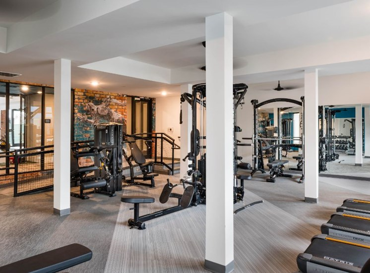 Large Open Fitness Center with Exercise Equipment