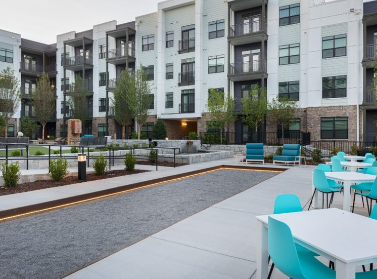 Courtyard Between Buildings with Tables and Chairs and Hammocks Bocce Ball Pit