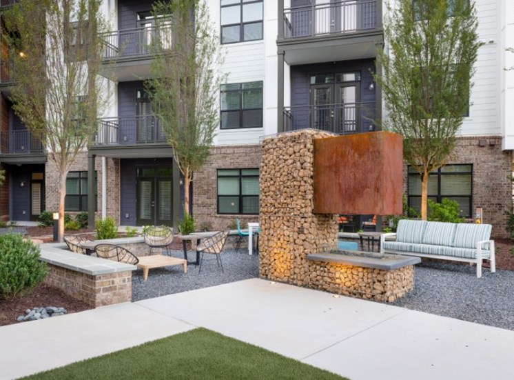 Courtyard Between Buildings with Tables and Chairs and Fireplace