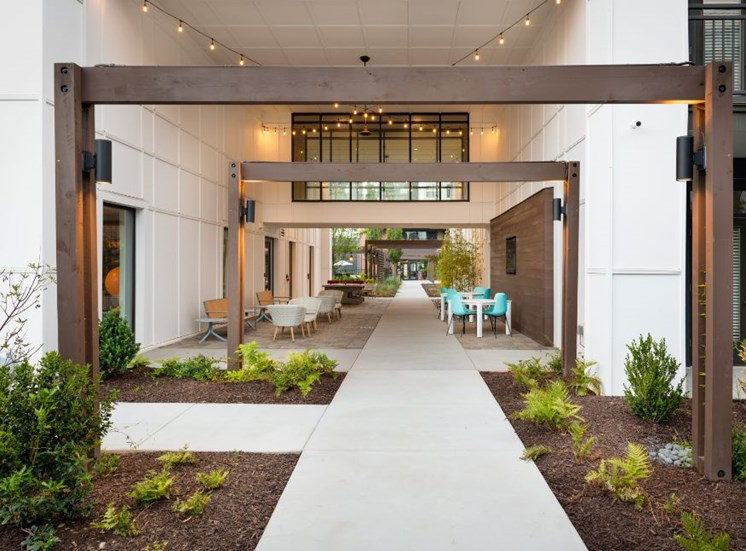 Walkway Between Two White Buildings with Lounge Seating
