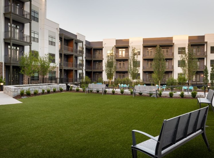 Grassy Courtyard Between Buildings  with Bench