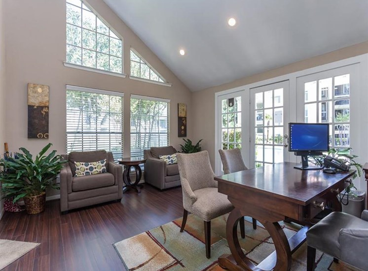 Leasing Office with large windows and hardwood style flooring