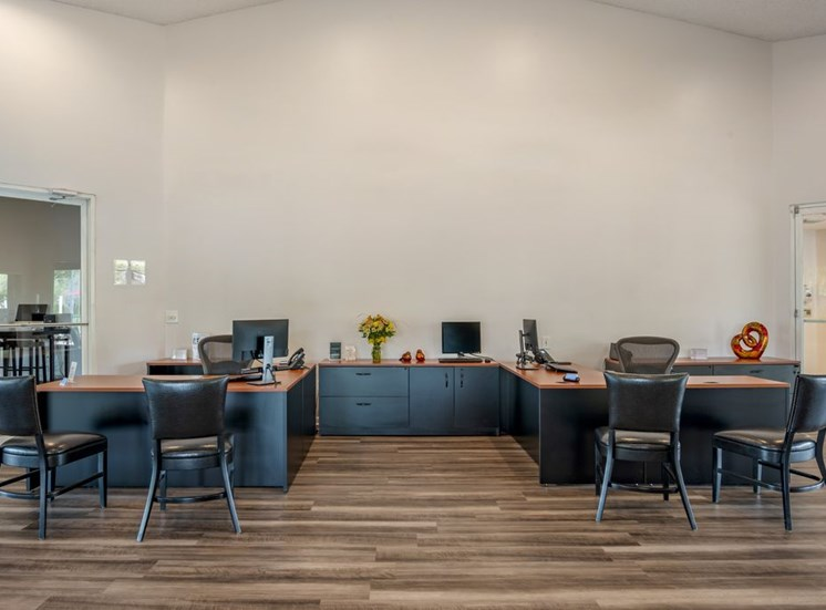 Leasing Office Interior with L Shaped Desks with Chairs and Filing Cabinets