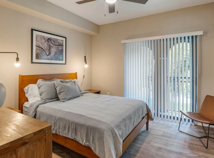 Model Bedroom with Contemporary Furniture and Sliding Glass Patio Door