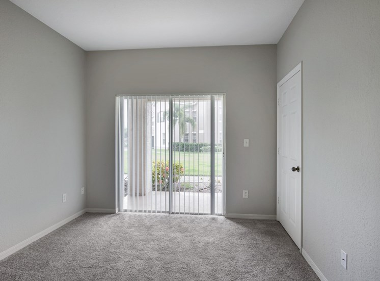 Carpeted Room with Sliding Glass Patio Door with Blinds