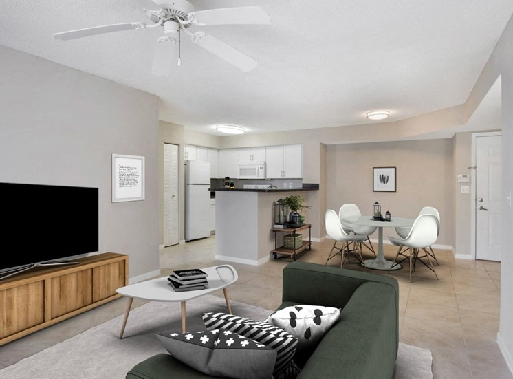 Virtual staged living room with entertainment center, tv, coffee table, decorative rug, dining room with dining table and chairs,  and large couch with three pillows