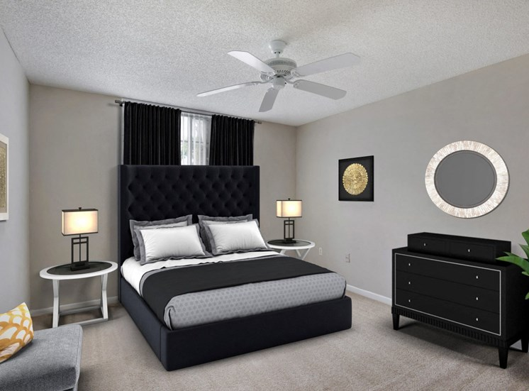 Virtual staged bedroom with a large bed with gray, black and white bedding, two night stand with white lamps, a dresser, black curtains, wall decor and a ceiling fan.