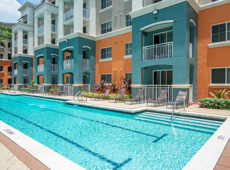 Swimming Pool with lp lanes and exterior of apartment building