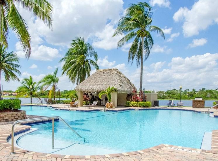 pool with cabana overlooking lake