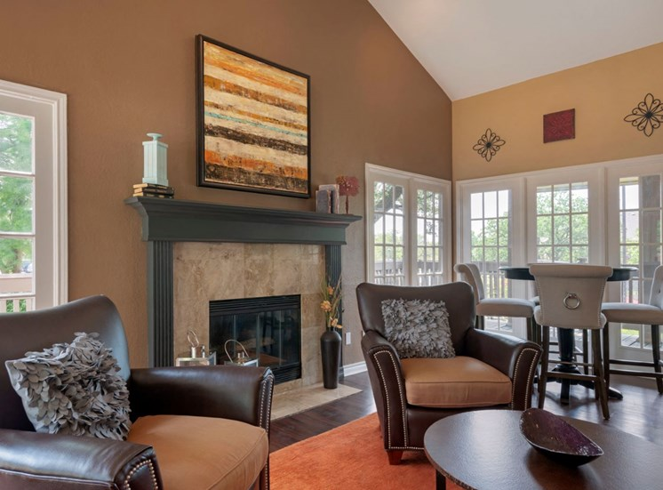 Clubhouse interior with dark and light tan painted walls, orange accents, and a fireplace