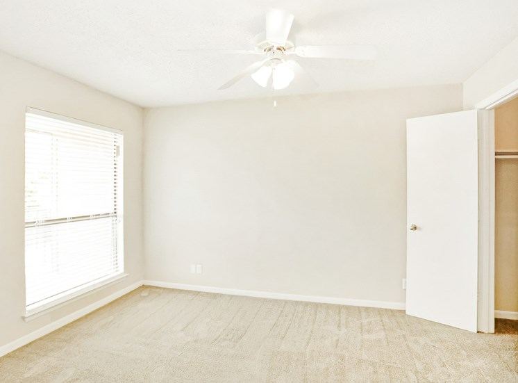 Bedroom with Ceiling Fan and a window