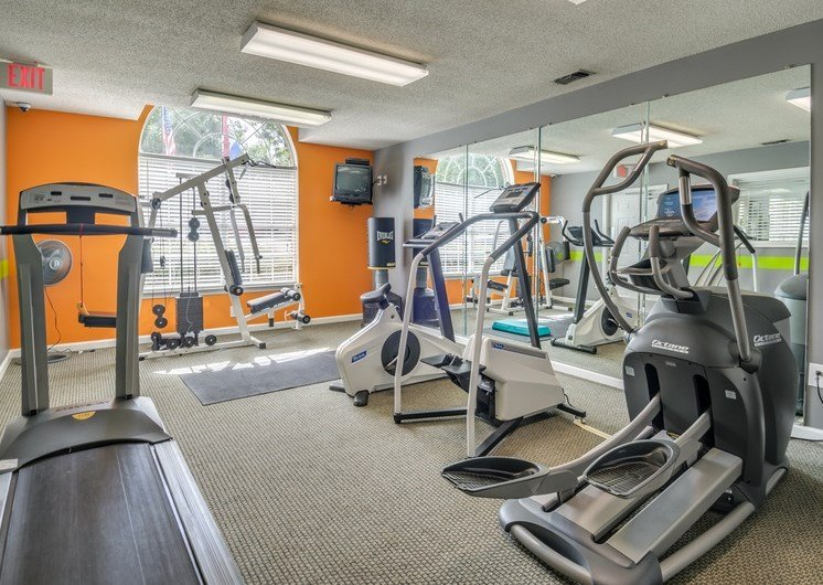 Fitness center with treadmill, stationary bikes and elliptical