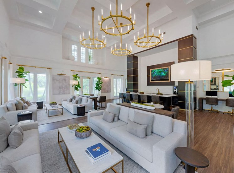 Clubhouse Seating Area with Contemporary Decorations Coffee Tables, Couches and Decorative Trees and Gold Chandeliers