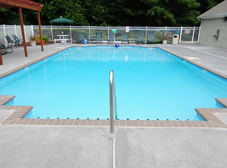 Swimming Pool With Lounge Chairs at Autumn Wind Apartments, Virginia