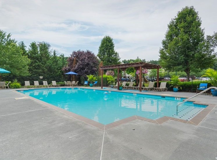 Pool Side Relaxing Area With Sundeck at Autumn Wind Apartments, Winchester