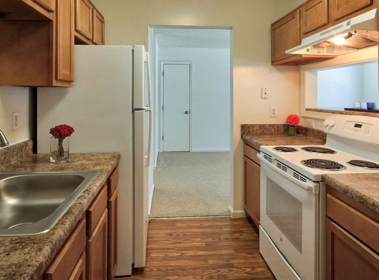 kitchen with stove and dishwasher. Cabinets above the appliances.