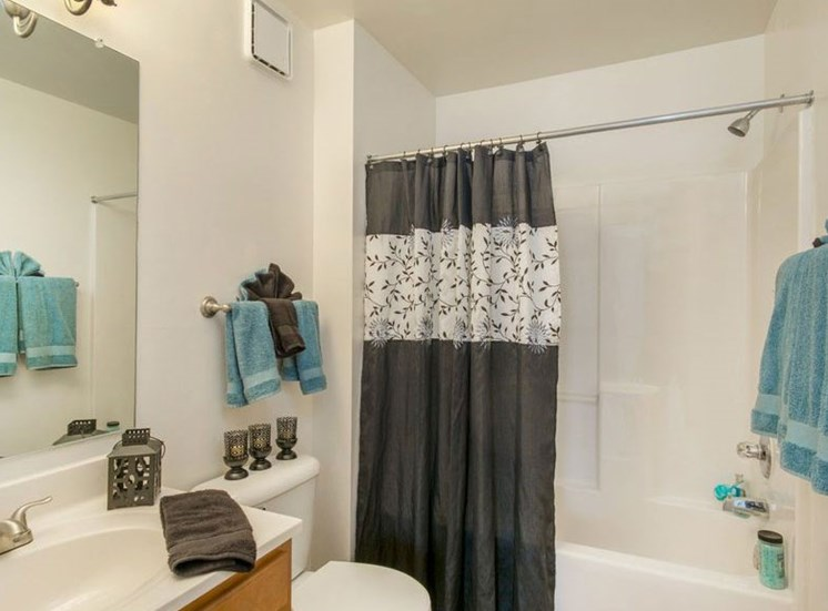 Bathroom with garden style bath tub. the vantiy has  white  counter tops