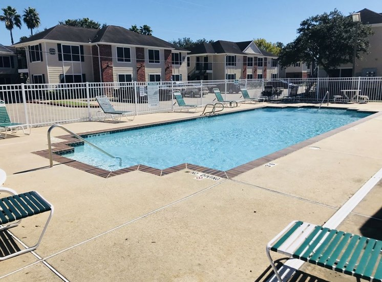 Swimming Pool and Sun Deck with Lounge Chairs at Falcon Pointe Apartments, Rosenberg, 77471