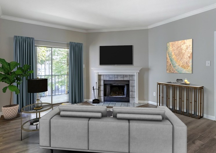 Living room with fireplace, window with blue curtains, and a mounted tv