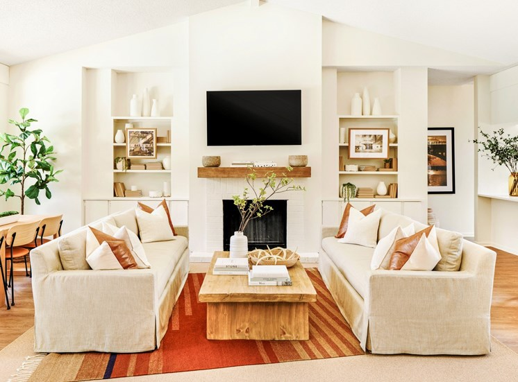 resident lounge area with a sofa, coffee table and fireplace
