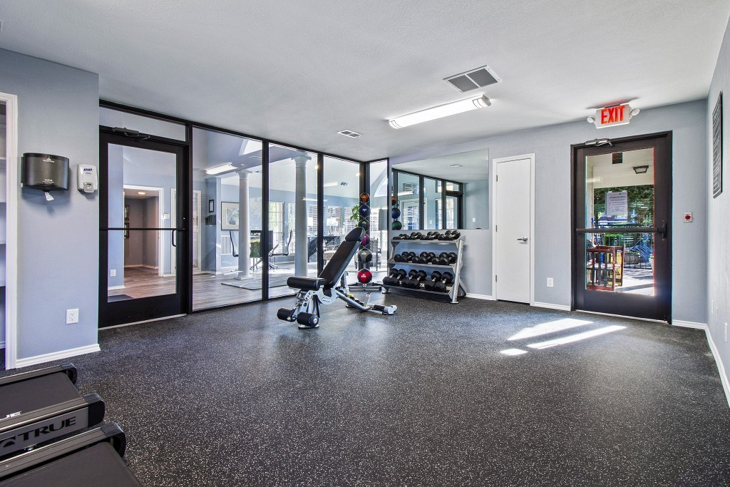 Fitness center with a glass wall facing the clubhouse.