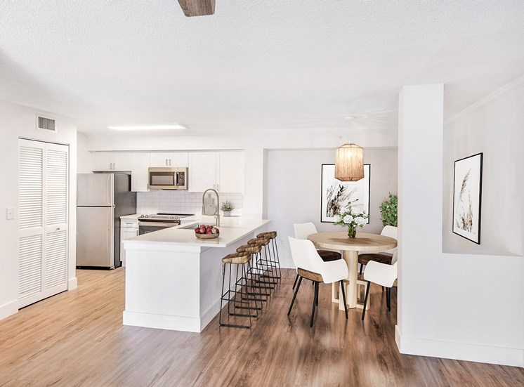Open Layout Model with Kitchen Breakfast Bar, Stainless Steel Appliances, Bar Stools, Dining Table and Chairs