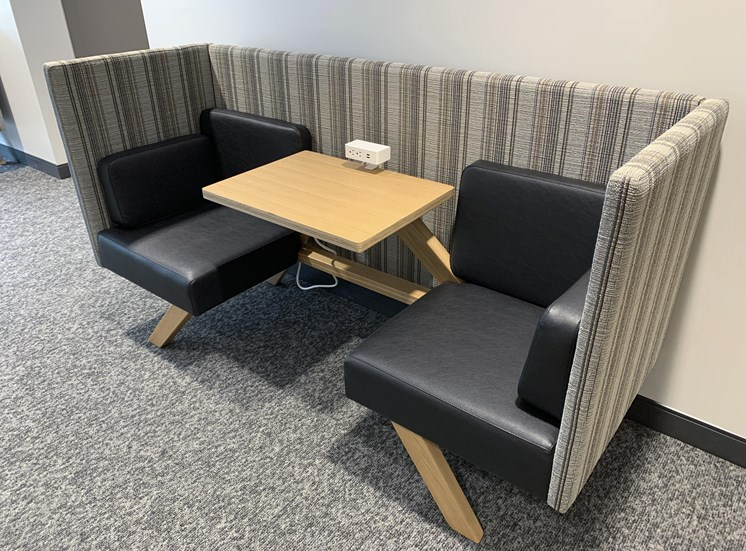 Booth with two seats, and table and outlets for working from home