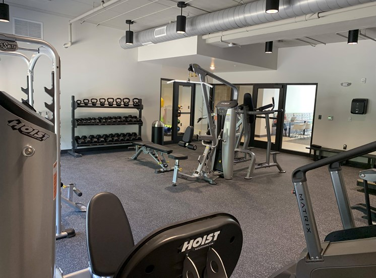 Fitness center with strength training and cardio equipment at Haven at Uptown