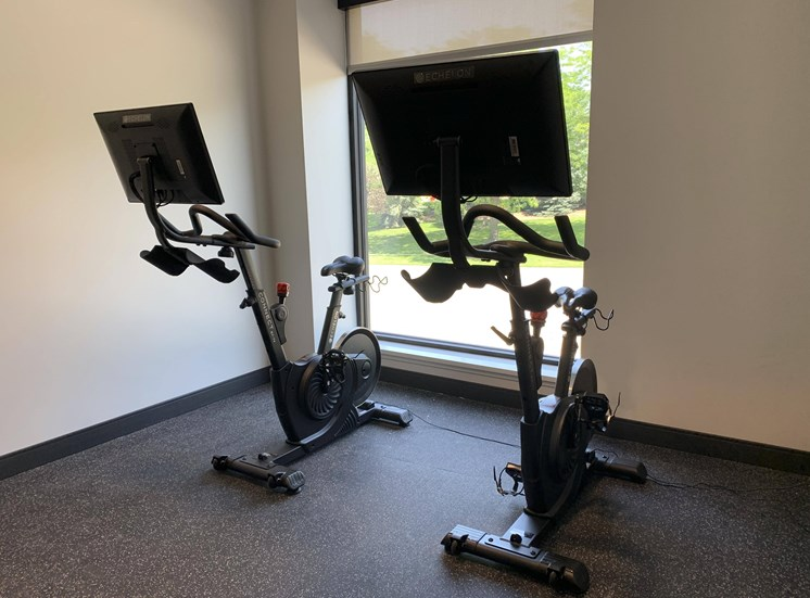spin bikes with large screens for on demand cycling classes in the fitness center at Haven at Uptown