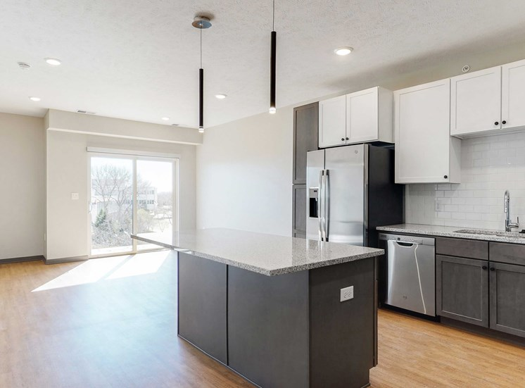 Open concept kitchen and living space in the Bliss floor plan at Haven at Uptown in Lincoln, NE