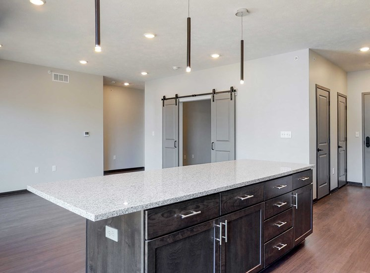 Beautiful kitchen island which provides plenty of extra storage with the additional cabinet space provided at Haven at Uptown in Lincoln, NE