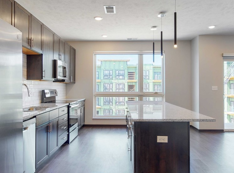 Spacious kitchen with mocha finishes in the Melody floor plan at Haven at Uptown in Lincoln, NE