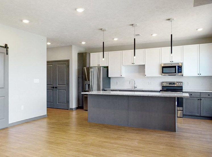 Kitchen island provides additional seating in the Melody floor plan at Haven at Uptown in Lincoln, NE