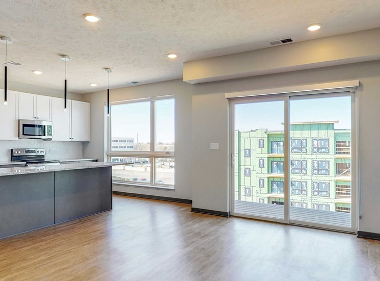 Kitchen and living space with abundant natural light in the Melody floor plan at Haven at Uptown in Lincoln, NE