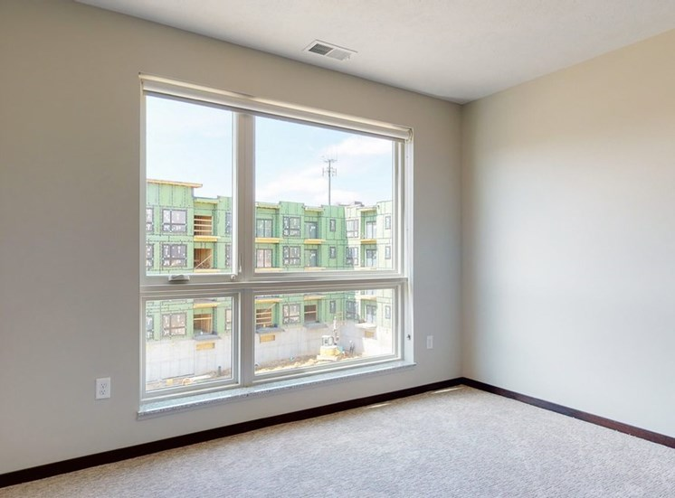 Natural light in bedroom provided by large windows at Haven at Uptown in Lincoln, NE