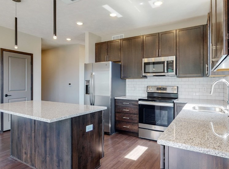 View of mocha style finishes in Shine floor plan kitchen at Haven at Uptown in Lincoln, NE