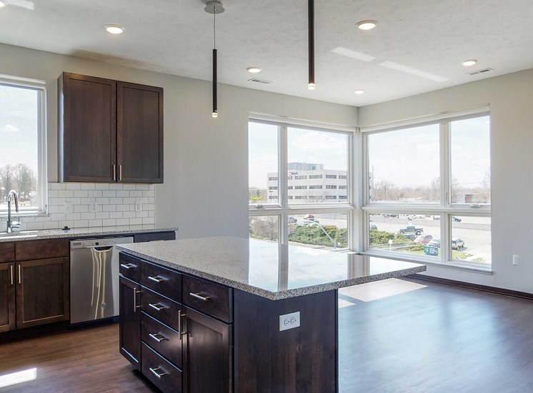 Kitchen and living space with abundant natural light at Haven at Uptown in Lincoln, NE