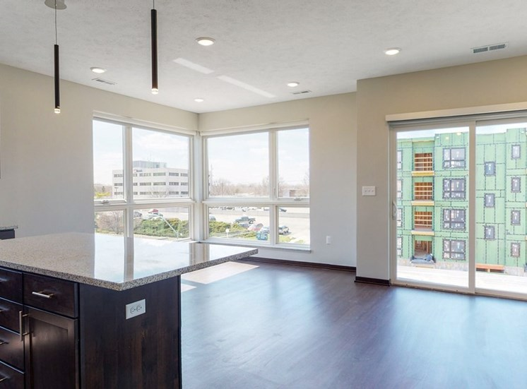 Open floor plan kitchen and living space in the Shine floor plan at Haven at Uptown in Lincoln, NE