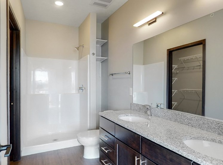 Large master bathroom with dual sink counters at Haven at Uptown in Lincoln, NE