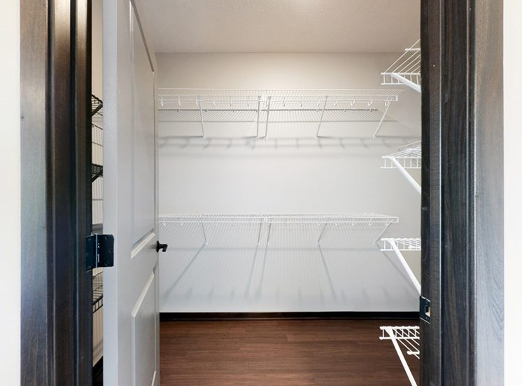 Master bedroom attached walk in closet provides plenty of extra storage space at Haven at Uptown in Lincoln, NE