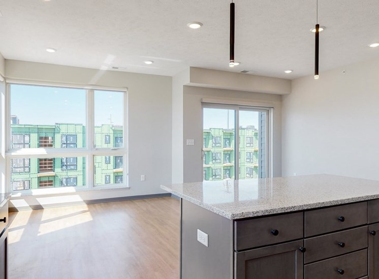 Island providing additional seating and storage space in the Shine floor plan at Haven at Uptown in Lincoln, NE