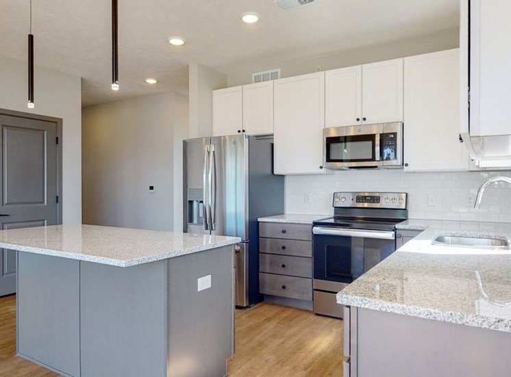 Two tone slate finishes in the Shine floor plan kitchen at Haven at Uptown in Lincoln, NE