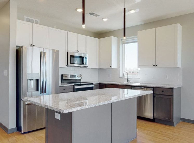 Kitchen and island seating with the slate finish style in the Shine floor plan at Haven at Uptown in Lincoln, NE