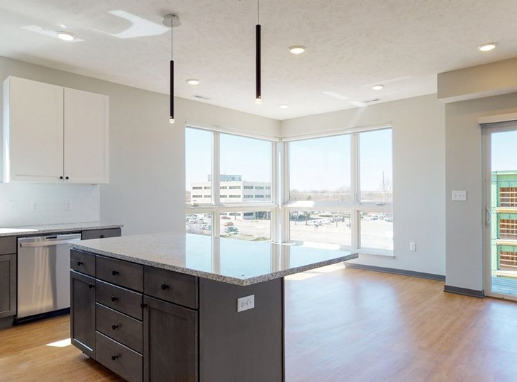 Open concept kitchen and living-dining space in the Shine floor plan at Haven at Uptown in Lincoln, NE