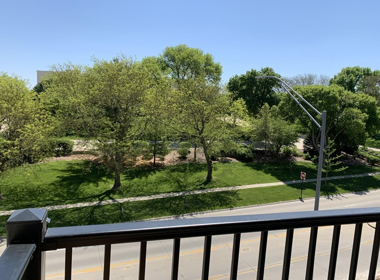 Scenic tree filled park view from outdoor balcony at Haven at Uptown in Lincoln.