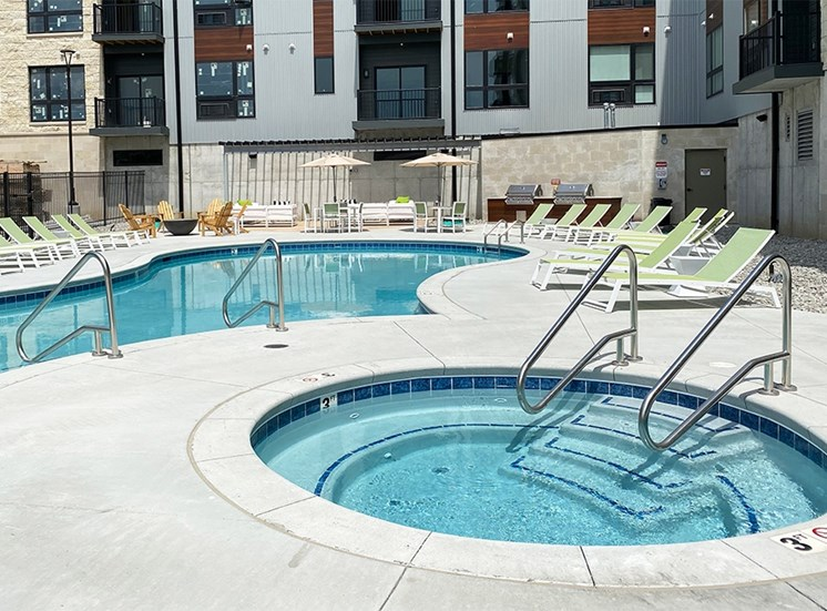 Circular spa hot tub near then outdoor resort style pool  at Haven at Uptown.