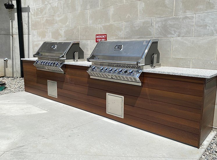 Two stainless steel grills built into in an outdoor kitchen at Haven at Uptown.