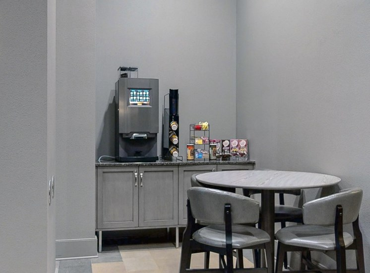 Grab a complimentary cup of coffee in the comfortable and modern lobby at Midtown Crossing Apartments