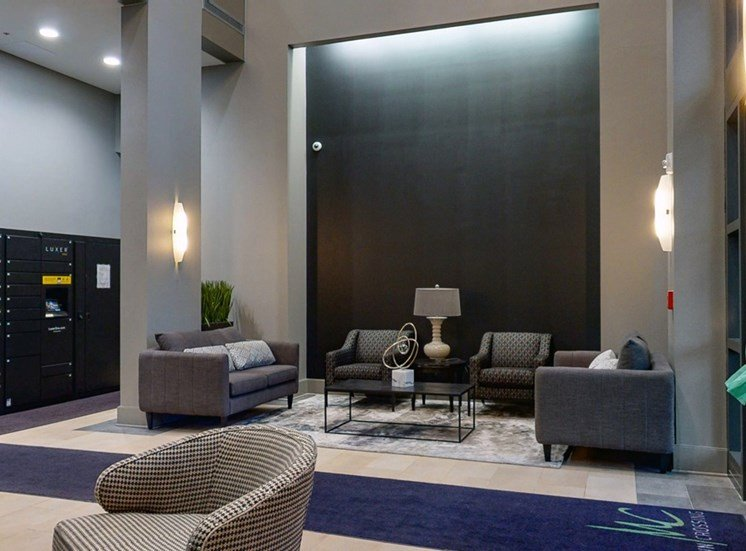 Sit back and relax in the modern lobby at Midtown Crossing Apartments in Omaha.